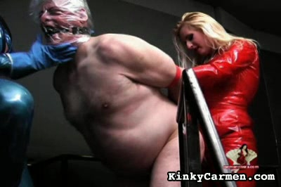 Cornered captive. The women drop hot wax on the cock and balls of their fat captive before butt-fucking him with a dildo